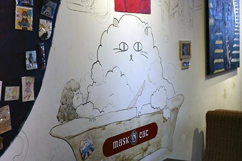 壁にはオーナーさんが描かれた可愛らしいイラストも